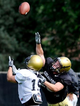 University of Colorado's Matt Meyer (rigth) covers Jason Espenoza (left) during football practice in Boulder, Colorado August 9, 2010.  CAMERA/Mark Leffingwell