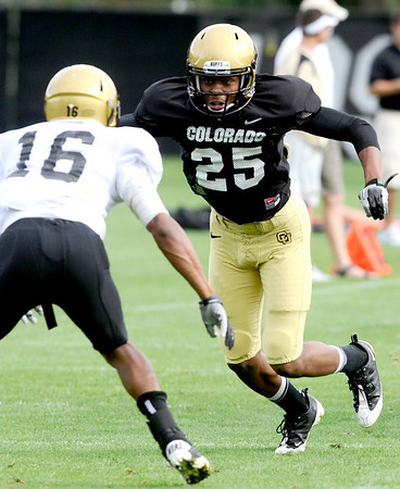 University of Colorado's Deji Olatoye (right) blocks Will Jefferson (left)  during football practice in Boulder, Colorado August 9, 2010.  CAMERA/Mark Leffingwell