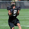 Jason Espinoza on punt returns (Photo by Cliff Grassmick).