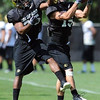 Kevid Moyd, left, and Jason Espinoza compete in a drill on Sunday (Photo by Cliff Grassmick).