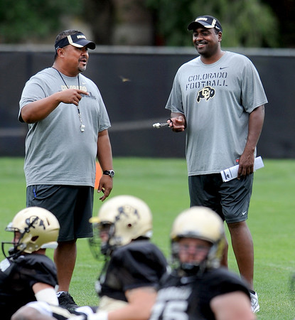 "Head coach Jon Embree, right, and assistant, Mike Tuiasosopo, joke during practice on Friday, August 26, 2011.<br /> For more photos of CU football, go to  <a href=""http://www.dailycamera.com"">http://www.dailycamera.com</a>.<br /> Cliff Grassmick / August 26, 2011"
