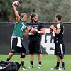 "Nick Hirschman, left, Gus Handler, and Brent Burnette, warm up before practice on August 26, 2011.<br /> For more photos of CU football, go to  <a href=""http://www.dailycamera.com"">http://www.dailycamera.com</a>.<br /> Cliff Grassmick / August 26, 2011"