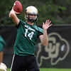 "QB John Schrock throws the ball in practice on Friday.<br /> For more photos of CU football, go to  <a href=""http://www.dailycamera.com"">http://www.dailycamera.com</a>.<br /> Cliff Grassmick / August 26, 2011"