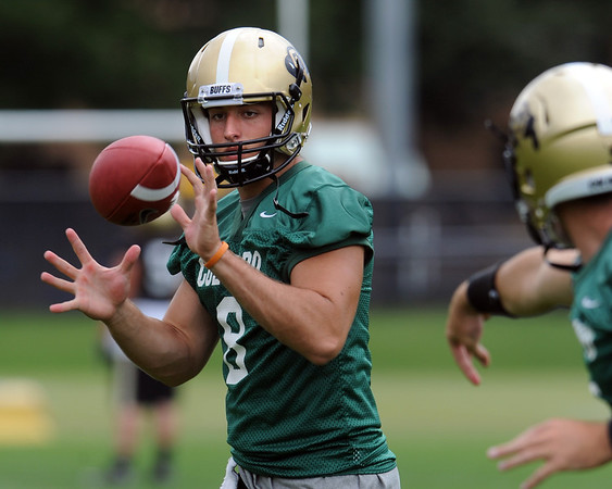"""Nick Hirschman catches a pitch out during practice on Friday.<br /> For more photos of CU football, go to  <a href=""""http://www.dailycamera.com"""">http://www.dailycamera.com</a>.<br /> Cliff Grassmick / August 26, 2011"""