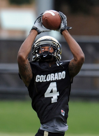 "Keenan Canty catches a pass during practice on August 26, 2011.<br /> For more photos of CU football, go to  <a href=""http://www.dailycamera.com"">http://www.dailycamera.com</a>.<br /> Cliff Grassmick / August 26, 2011"