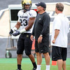 Jalil Brown (23) talks to Ron Collins during the Thursday scrimmage (Photo by Cliff Grassmick).