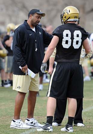 "Head CU football coach, Jon Embree, talks to Kyle Slavin  during day 2 of Spring drills.<br /> For more photos and videos, go to  <a href=""http://www.dailycamera.com"">http://www.dailycamera.com</a>.<br /> Cliff Grassmick/ March 12, 2011"