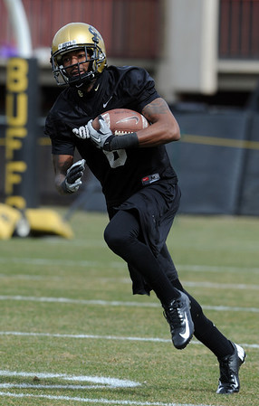 """Paul Richardson works on punt returns during day 2 of Spring practice.<br /> For more photos and videos, go to  <a href=""""http://www.dailycamera.com"""">http://www.dailycamera.com</a>.<br /> Cliff Grassmick/ March 12, 2011"""