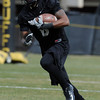 "Paul Richardson works on punt returns during day 2 of Spring practice.<br /> For more photos and videos, go to  <a href=""http://www.dailycamera.com"">http://www.dailycamera.com</a>.<br /> Cliff Grassmick/ March 12, 2011"