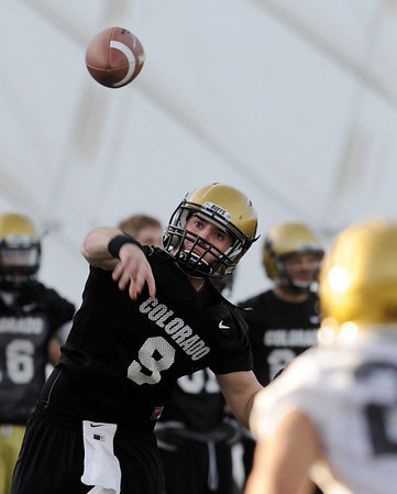 "Tyler Hansen throws in the first Spring practice.<br /> For a videos and photos of the practice, go to  <a href=""http://www.dailycamera.com"">http://www.dailycamera.com</a>.<br /> Cliff Grassmick/ March 11, 2011"