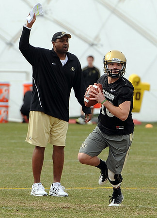 """Head CU football coach, Jon Embree, watches Brent Burnette during day 2 of Spring drills.<br /> For more photos and videos, go to  <a href=""""http://www.dailycamera.com"""">http://www.dailycamera.com</a>.<br /> Cliff Grassmick/ March 12, 2011"""