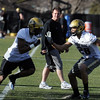 "Greg Brown is back coaching at CU.<br /> For a videos and photos of the practice, go to  <a href=""http://www.dailycamera.com"">http://www.dailycamera.com</a>.<br /> Cliff Grassmick/ March 11, 2011"
