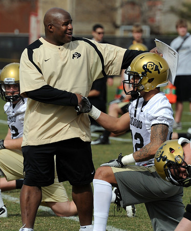 """Eric Bieniemy, CU offensive coordinator, walks through the players during stretching on day 2 of Spring ball.<br /> For more photos and videos, go to  <a href=""""http://www.dailycamera.com"""">http://www.dailycamera.com</a>.<br /> Cliff Grassmick/ March 12, 2011"""