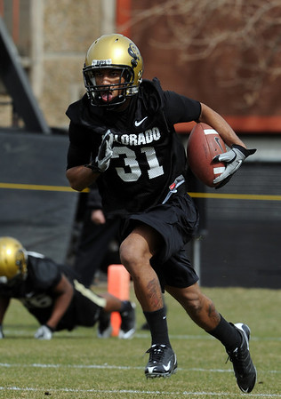 "Keenan Canty works on punt returns during day 2 of Spring practice.<br /> For more photos and videos, go to  <a href=""http://www.dailycamera.com"">http://www.dailycamera.com</a>.<br /> Cliff Grassmick/ March 12, 2011"