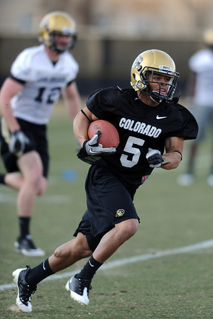 """Rodney Stewart takes off on a run during Spring practice.<br /> For a videos and photos of the practice, go to  <a href=""""http://www.dailycamera.com"""">http://www.dailycamera.com</a>.<br /> Cliff Grassmick/ March 11, 2011"""