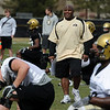 "Eric Bieniemy, CU offensive coordinator, walks through the players during stretching on day 2 of Spring ball.<br /> For more photos and videos, go to  <a href=""http://www.dailycamera.com"">http://www.dailycamera.com</a>.<br /> Cliff Grassmick/ March 12, 2011"