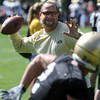 "Coach Bobby Kennedy throws passes to receivers during drills.<br /> For more photos and a video from CU football today, go to  <a href=""http://www.dailycamera.com"">http://www.dailycamera.com</a>.<br /> Cliff Grassmick / August 17, 2011"