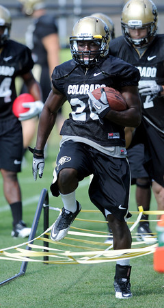 "Brian Lockridge runs drills during practice on Wednesday.<br /> For more photos and a video from CU football today, go to  <a href=""http://www.dailycamera.com"">http://www.dailycamera.com</a>.<br /> Cliff Grassmick / August 17, 2011"