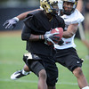 "Toney Clemons (17) catches a ball around Greg Henderson on Wednesday.<br /> For more photos and a video from CU football today, go to  <a href=""http://www.dailycamera.com"">http://www.dailycamera.com</a>.<br /> Cliff Grassmick / August 17, 2011"