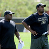 "Eric Bieniemy, left, and Jon Embree watch practice on Wednesday.<br /> For more photos and a video from CU football today, go to  <a href=""http://www.dailycamera.com"">http://www.dailycamera.com</a>.<br /> Cliff Grassmick / August 17, 2011"