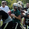 "John Schrock (14) moves around in the crowd before passing.<br /> For more photos and a video from CU football today, go to  <a href=""http://www.dailycamera.com"">http://www.dailycamera.com</a>.<br /> Cliff Grassmick / August 17, 2011"