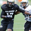 "Toney Clemons (17) tries to work around Greg Henderson on Wednesday.<br /> For more photos and a video from CU football today, go to  <a href=""http://www.dailycamera.com"">http://www.dailycamera.com</a>.<br /> Cliff Grassmick / August 17, 2011"