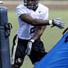 "Juda Parker slaps around the bags during drills on Wednesday.<br /> For more photos and a video from CU football today, go to  <a href=""http://www.dailycamera.com"">http://www.dailycamera.com</a>.<br /> Cliff Grassmick / August 17, 2011"