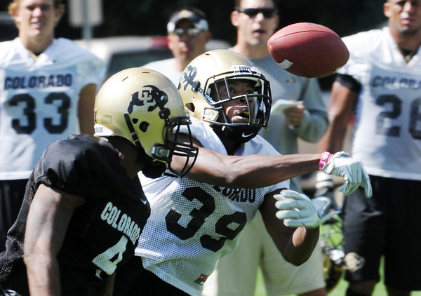 "Josh Moten (39) tries to get an interception from Keenan Canty at practice on Wednesday.<br /> For more photos and a video from CU football today, go to  <a href=""http://www.dailycamera.com"">http://www.dailycamera.com</a>.<br /> Cliff Grassmick / August 17, 2011"