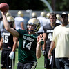 """John Schrock passes as Jon Embree watches on Thursday.<br /> For a video and photos of today's practice, go to  <a href=""""http://www.dailycamera.com"""">http://www.dailycamera.com</a>.<br /> Cliff Grassmick / August 18, 2011"""