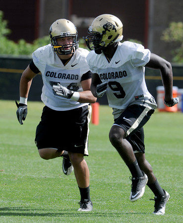 "Brady Daigh, left, and Childera Uzo-Diribe (9) work on drills on Thursday.<br /> For a video and photos of today's practice, go to  <a href=""http://www.dailycamera.com"">http://www.dailycamera.com</a>.<br /> Cliff Grassmick / August 18, 2011"
