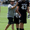 """Assistant coach, J.D. Brookhart, during Thursday's practice. Matt Bahr is on the right.<br /> For a video and photos of today's practice, go to  <a href=""""http://www.dailycamera.com"""">http://www.dailycamera.com</a>.<br /> Cliff Grassmick / August 18, 2011"""