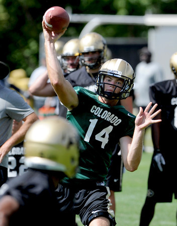 "John Schrock works during the Thursday's practice.<br /> For a video and photos of today's practice, go to  <a href=""http://www.dailycamera.com"">http://www.dailycamera.com</a>.<br /> Cliff Grassmick / August 18, 2011"