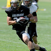 """Nelson Spruce takes off with a pass on Thursday.<br /> For a video and photos of today's practice, go to  <a href=""""http://www.dailycamera.com"""">http://www.dailycamera.com</a>.<br /> Cliff Grassmick / August 18, 2011"""