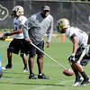 "Kanavis McGhee works with the defense  during practice on Thursday.<br /> For a video and photos of today's practice, go to  <a href=""http://www.dailycamera.com"">http://www.dailycamera.com</a>.<br /> Cliff Grassmick / August 18, 2011"