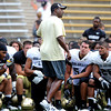 "University of Colorado football coach, Jon Embree, talks to the team after the Friday scrimmage.<br /> For more photos and videos from Friday, go to  <a href=""http://www.dailycamera.com"">http://www.dailycamera.com</a><br /> Cliff Grassmick / August 19, 2011"