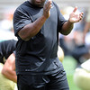 "Offensive coordinator, Eric Bieniemy, claps during warmups on Friday.<br /> For more photos and videos from Friday, go to  <a href=""http://www.dailycamera.com"">http://www.dailycamera.com</a><br /> Cliff Grassmick / August 19, 2011"