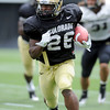 """Tony Jones runs back a kick return during Friday's scrimmage.<br /> For more photos and videos from Friday, go to  <a href=""""http://www.dailycamera.com"""">http://www.dailycamera.com</a><br /> Cliff Grassmick / August 19, 2011"""