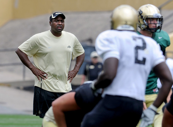 "University of Colorado football coach, Jon Embree, watches  the Friday scrimmage.<br /> For more photos and videos from Friday, go to  <a href=""http://www.dailycamera.com"">http://www.dailycamera.com</a><br /> Cliff Grassmick / August 19, 2011"