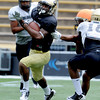"Keenan Canty runs in a kick-off return in Friday's scrimmage.<br /> For more photos and videos from Friday, go to  <a href=""http://www.dailycamera.com"">http://www.dailycamera.com</a><br /> Cliff Grassmick / August 19, 2011"