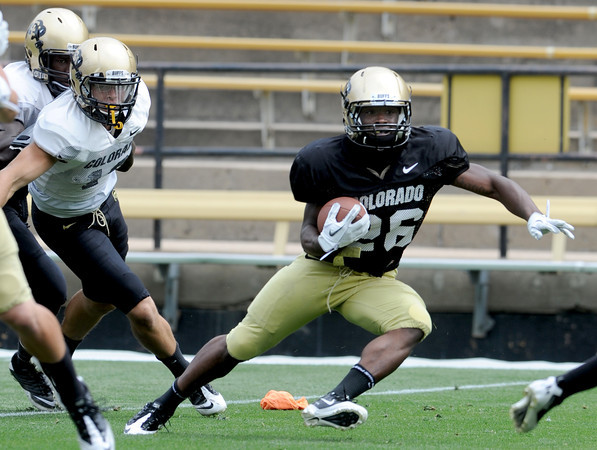 "Tony Jones makes a move during a kick return during Friday's scrimmage.<br /> For more photos and videos from Friday, go to  <a href=""http://www.dailycamera.com"">http://www.dailycamera.com</a><br /> Cliff Grassmick / August 19, 2011"