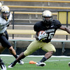 """Tony Jones makes a move during a kick return during Friday's scrimmage.<br /> For more photos and videos from Friday, go to  <a href=""""http://www.dailycamera.com"""">http://www.dailycamera.com</a><br /> Cliff Grassmick / August 19, 2011"""
