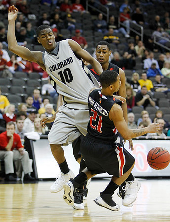 Colorado guard Alec Burks (10) and Texas Tech guard John Roberson (21) collide during the first half of an NCAA college basketball game at the Big 12 Conference tournament on Wednesday, March 10, 2010, in Kansas City, Kan. (AP Photo/Charlie Neibergall)