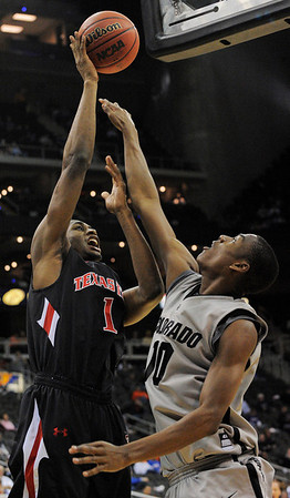 Texas Tech forward Brad Reese (1) shoots over Colorado guard Alec Burks (10) during the first half of an NCAA college basketball game at the Big 12 Conference tournament on Wednesday, March 10, 2010, in Kansas City, Kan. (AP Photo/Reed Hoffmann)