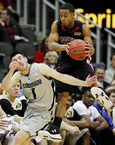 Texas Tech guard John Roberson (21) catches the ball while covered by Colorado guard Nate Tomlinson (1) during the second half of a NCAA college basketball game at the Big 12 Conference Tournament Wednesday, March 10, 2010, in Kansas City, Kan. (AP Photo/Charlie Neibergall)