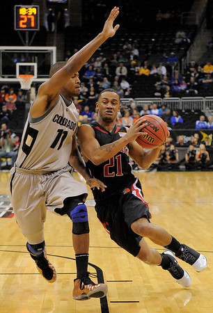 Texas Tech guard John Roberson (21) drives on Colorado guard Cory Higgins (11) during the first half of a NCAA college basketball game at the Big 12 Conference Tournament Wednesday, March 10, 2010, in Kansas City, Kan. (AP Photo/Reed Hoffmann)