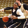 "Shannon Sharpe drives around Nate Tomlinson, right, during the University of Colorado Men's basketball team practice Tuesday morning October 19, 2010 at the Coors Events Center on the CU Boulder Campus. FOR MORE PHOTOS GO TO  <a href=""http://WWW.DAILYCAMERA.COM"">http://WWW.DAILYCAMERA.COM</a>"