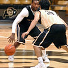 "#2 Shannon Sharpe dribbles against #35 Hassan Safieddine during the University of Colorado Men's basketball team practice Tuesday morning October 19, 2010 at the Coors Events Center on the CU Boulder Campus. FOR MORE PHOTOS GO TO  <a href=""http://WWW.DAILYCAMERA.COM"">http://WWW.DAILYCAMERA.COM</a>"
