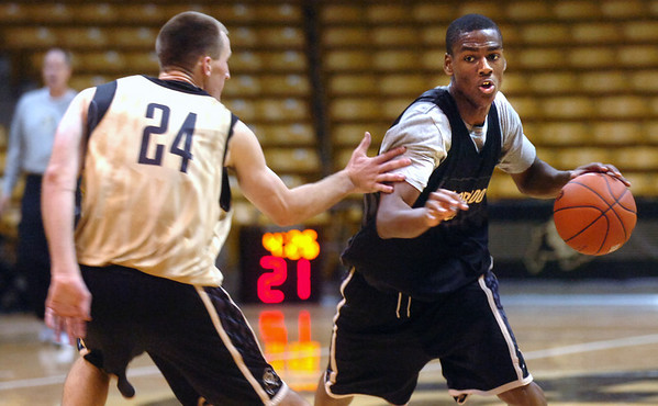 "#24 Levi Knutson, left, defends, #10 Alec Burks during the University of Colorado Men's basketball team practice Tuesday morning October 19, 2010 at the Coors Events Center on the CU Boulder Campus. FOR MORE PHOTOS GO TO  <a href=""http://WWW.DAILYCAMERA.COM"">http://WWW.DAILYCAMERA.COM</a>"