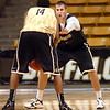 "#33 Austin Dufault, right, guards #14 Javon Coney  during the University of Colorado Men's basketball team practice Tuesday morning October 19, 2010 at the Coors Events Center on the CU Boulder Campus. FOR MORE PHOTOS GO TO  <a href=""http://WWW.DAILYCAMERA.COM"">http://WWW.DAILYCAMERA.COM</a>"