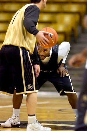 """#2 Shannon Sharpe guards #1 Nate Tomlinson during the University of Colorado Men's basketball team practice Tuesday morning October 19, 2010 at the Coors Events Center on the CU Boulder Campus. FOR MORE PHOTOS GO TO  <a href=""""http://WWW.DAILYCAMERA.COM"""">http://WWW.DAILYCAMERA.COM</a>"""